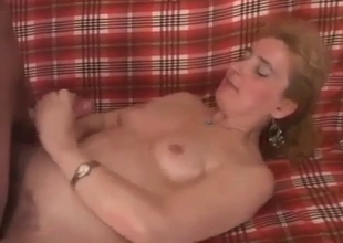 Filthy mom gets a cumshot by her horny son