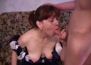 Redhead auntie pulls out my dick to give a head