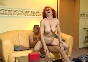 Skinny redhead auntie enjoys hardcore dick riding